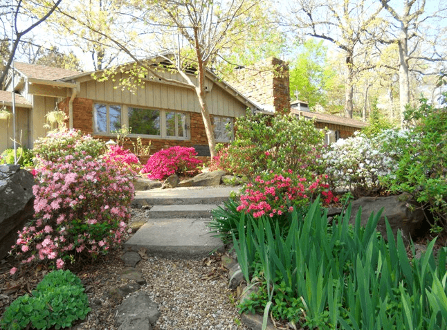 Split-level house on hill with landscaping to increase curb appeal.