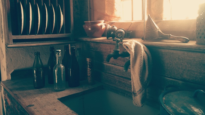 A sink in a home for sale that has defects that would need to be disclosed in a transaction.