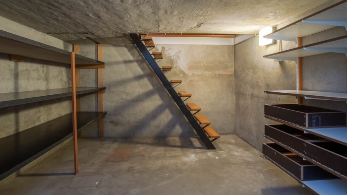 A dry basement in a house with a sump pump.