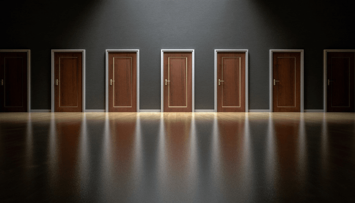 Doors representing options when selling a house with code violations.