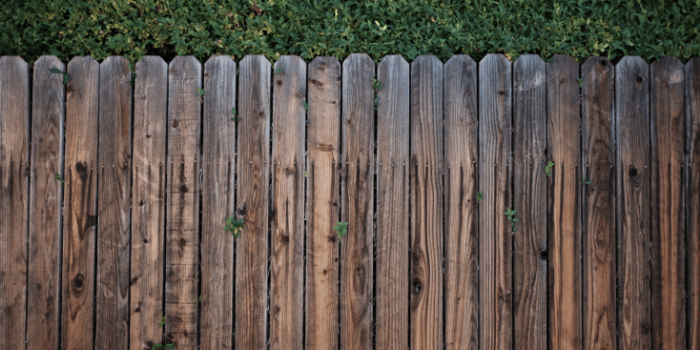 how to hide garbage cans outside- fence