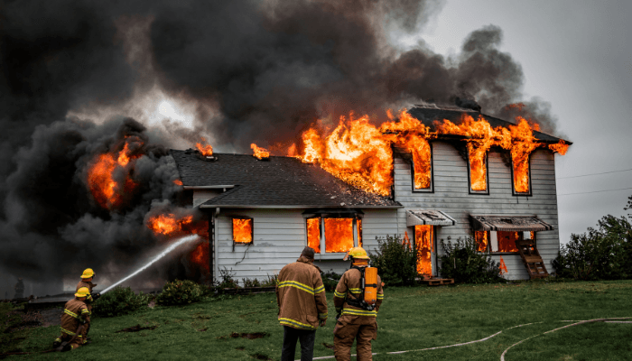 A house with homeowners insurance on fire.