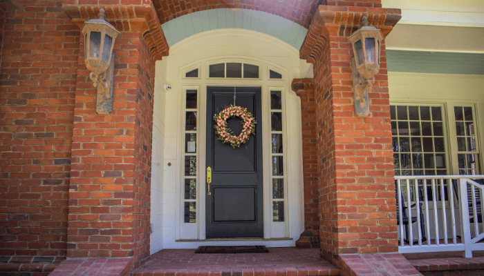 A front door color on a brick house.