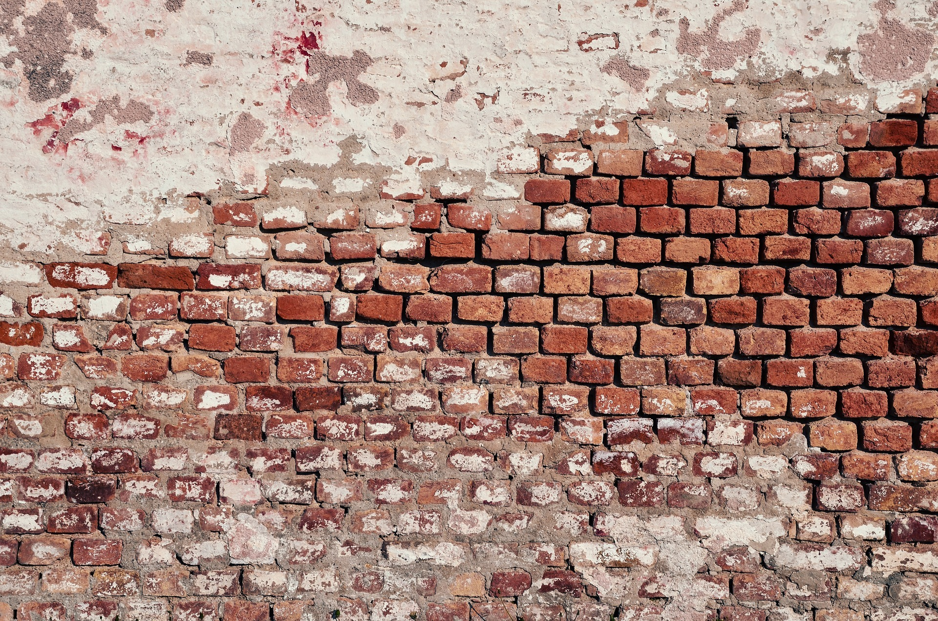 A brick wall with a red color.