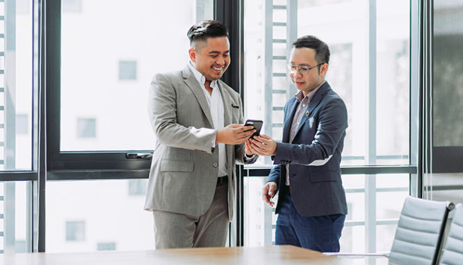 Two business people talking in an office.
