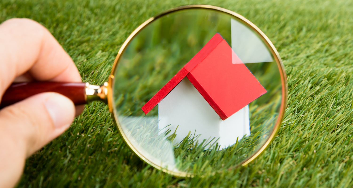 A magnifying glass over a new construction home.