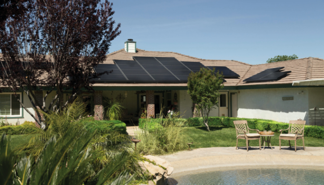 A home with solar panels on the roof, which may increase property value.