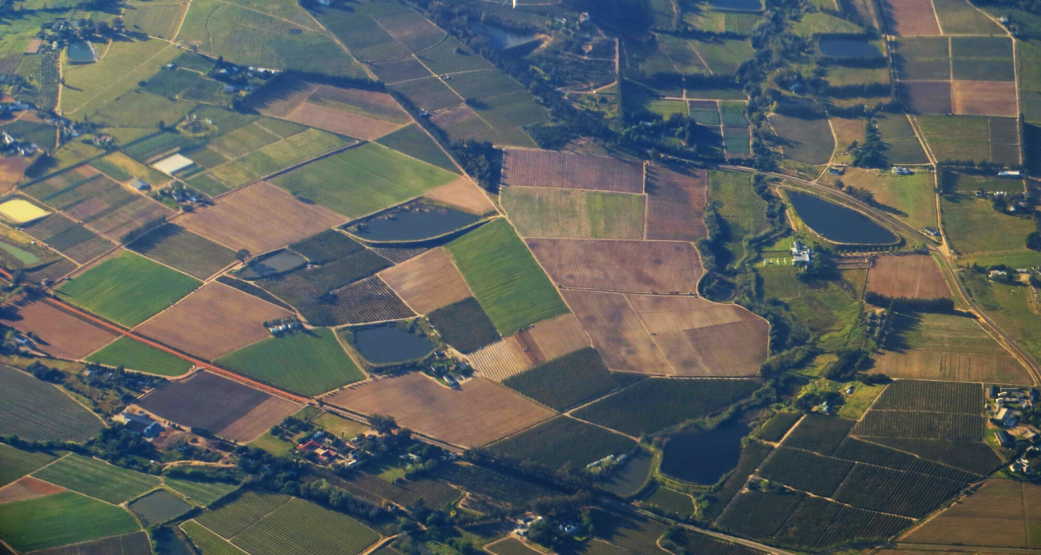 An aerial view of land that you could build a house on.