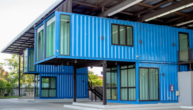 A stack of shipping containers that have been turned into a house you can build yourself.