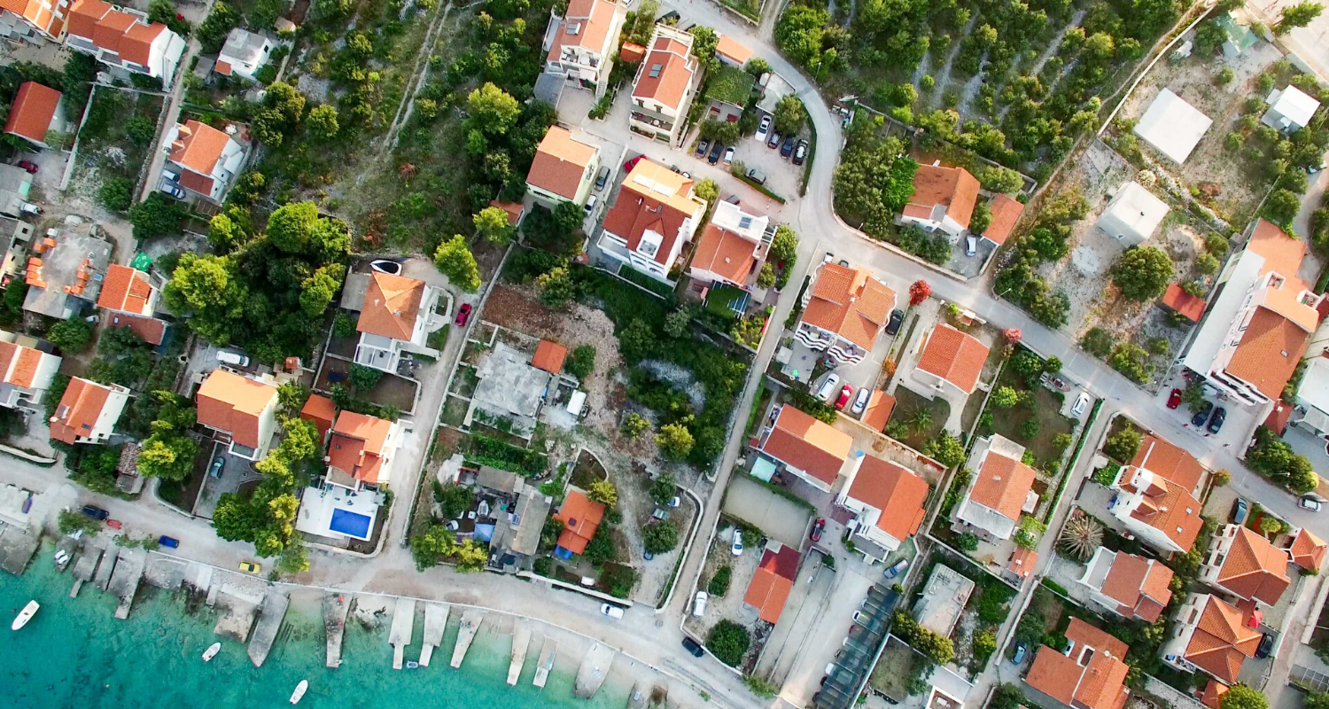 An aerial view of houses you can buy using a real estate agent.