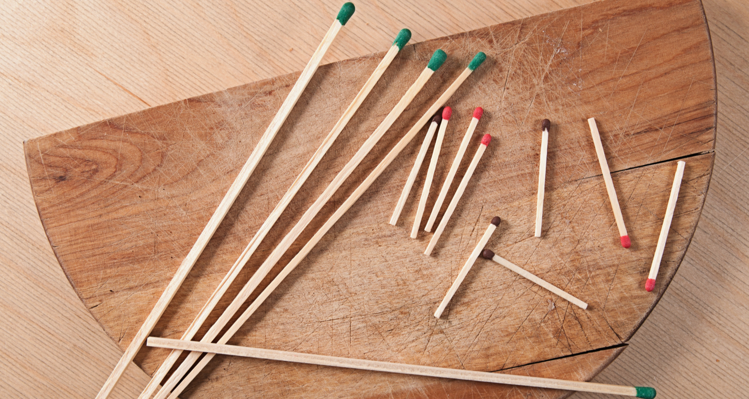 Long and short matches in bulk on a table to symbolize a short sale