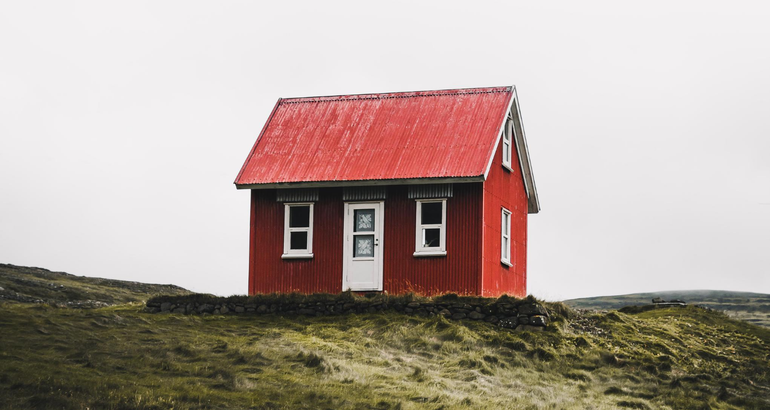 An image of a house represents the process of buying and selling at the same time.