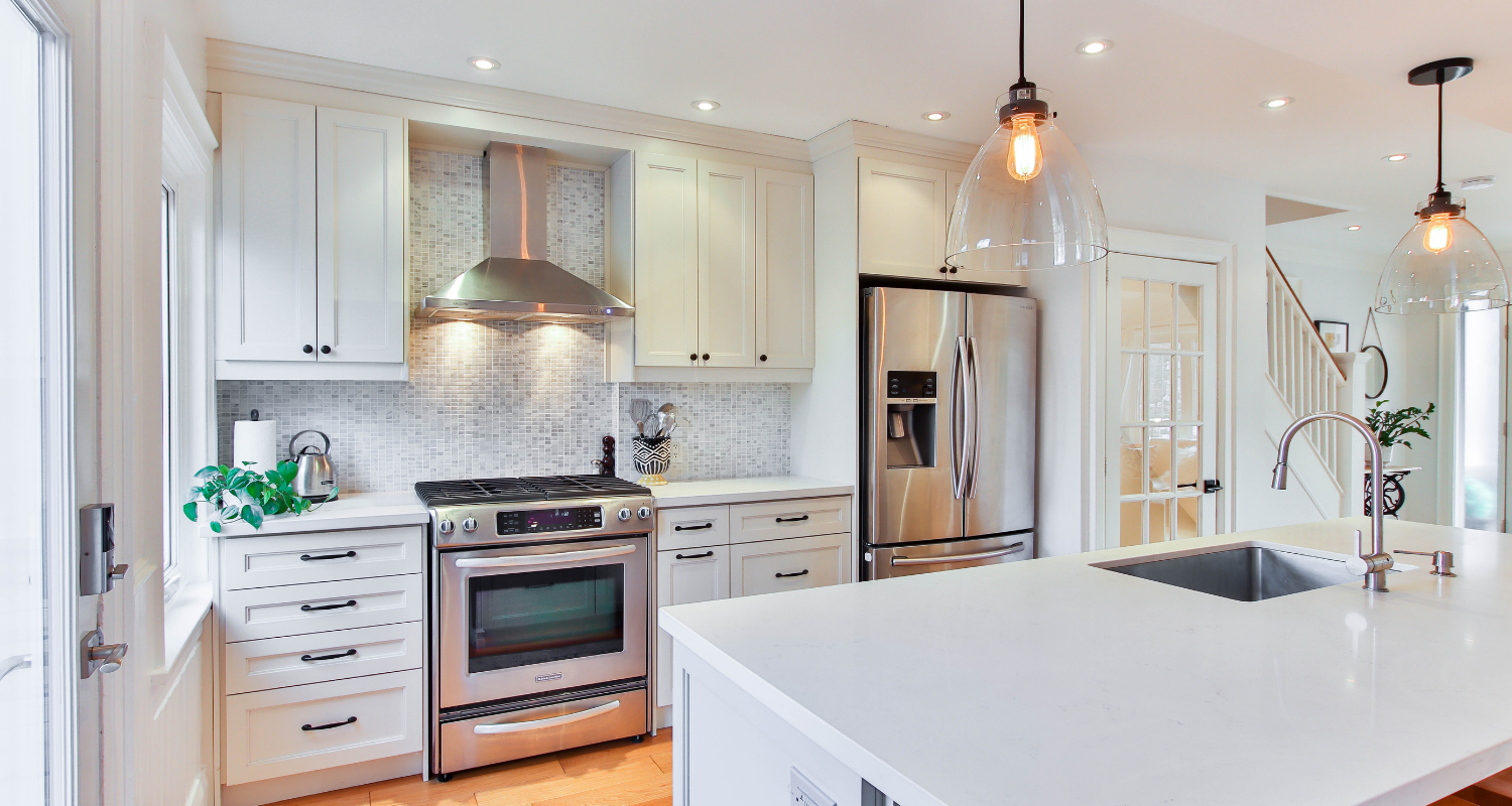 A kitchen with appliances in a house.