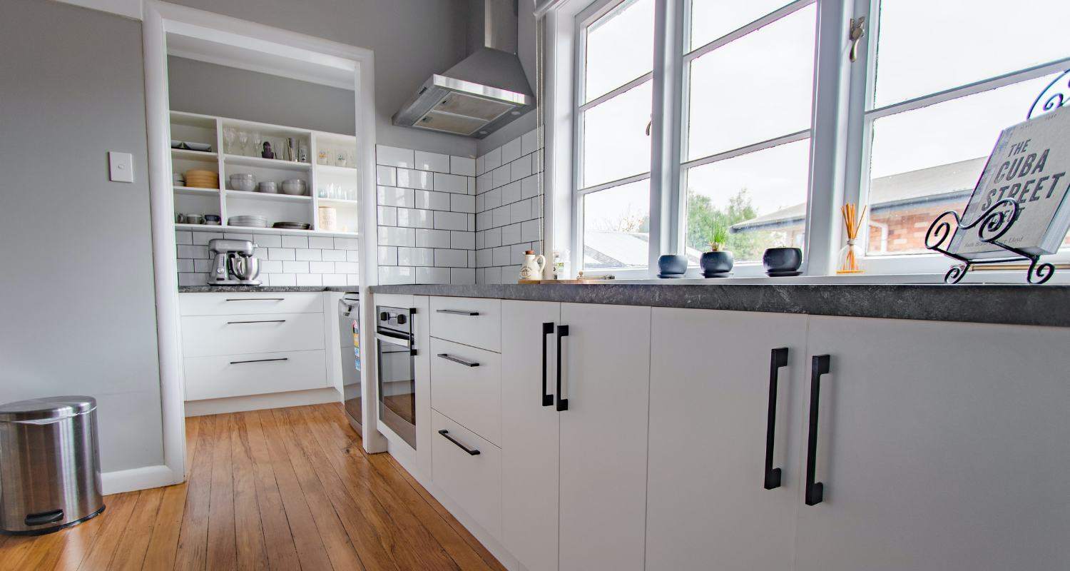 A kitchen with subway tiles that are in style.