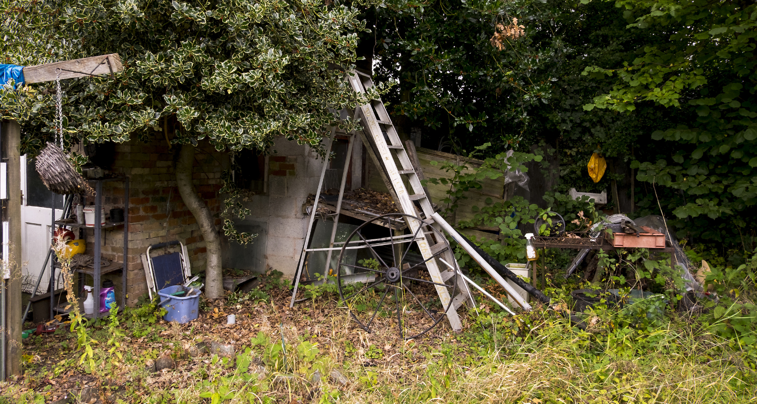 A neighbor's yard with junk in it.