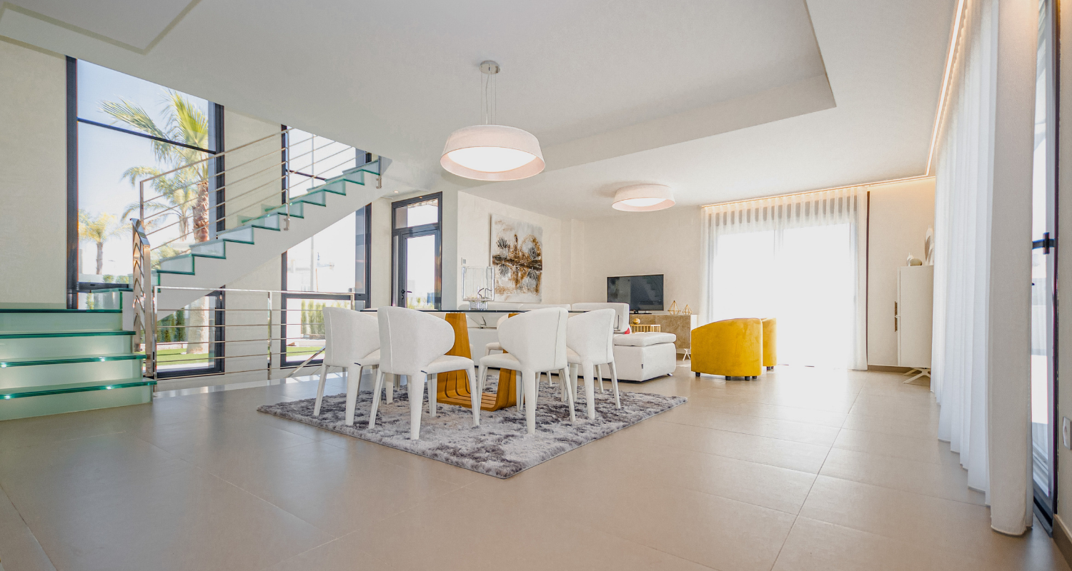 An open concept home with a dining table in the middle.