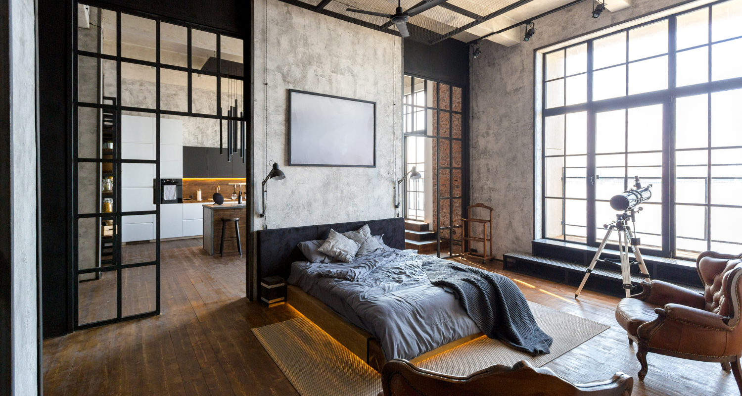 A loft apartment with a bed.