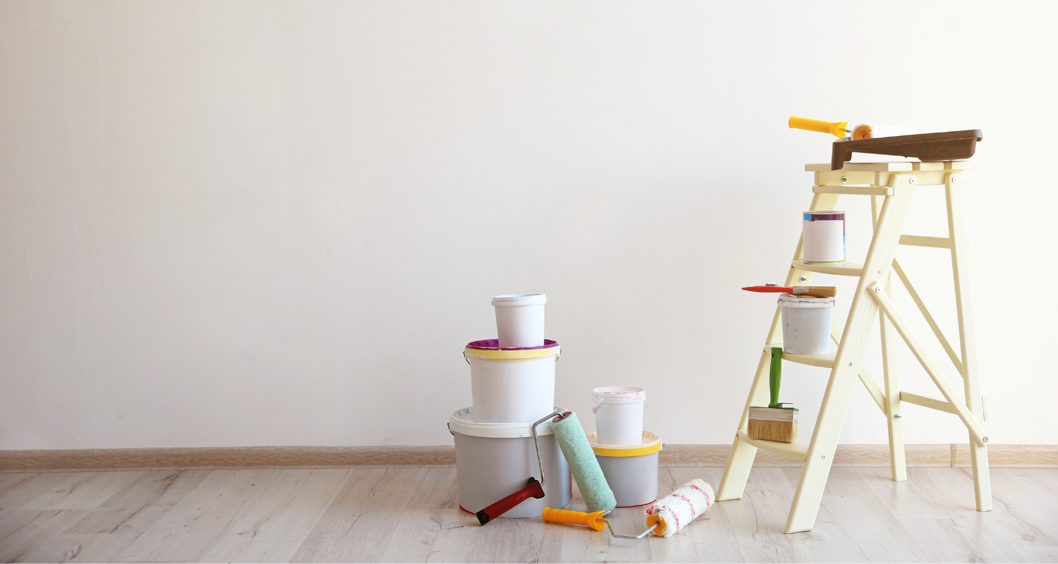 An image of painting supplies used to demonstrate what not to fix when selling a house.