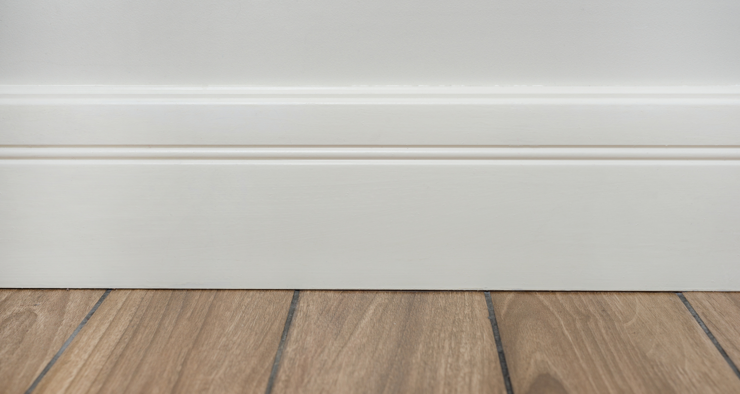 A wall with trim that has been painted white.