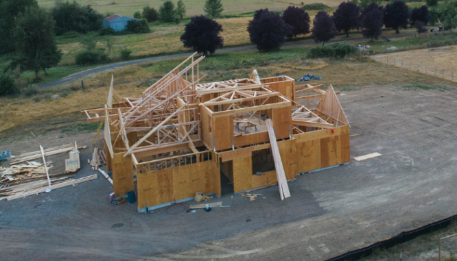 The framework of a new home, which is one of many steps to building a new house.