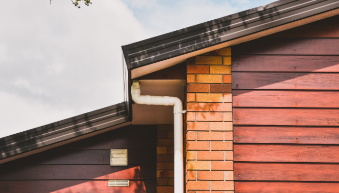 The roof and gutter of a house, both of which should be part of your new construction checklist inspections.