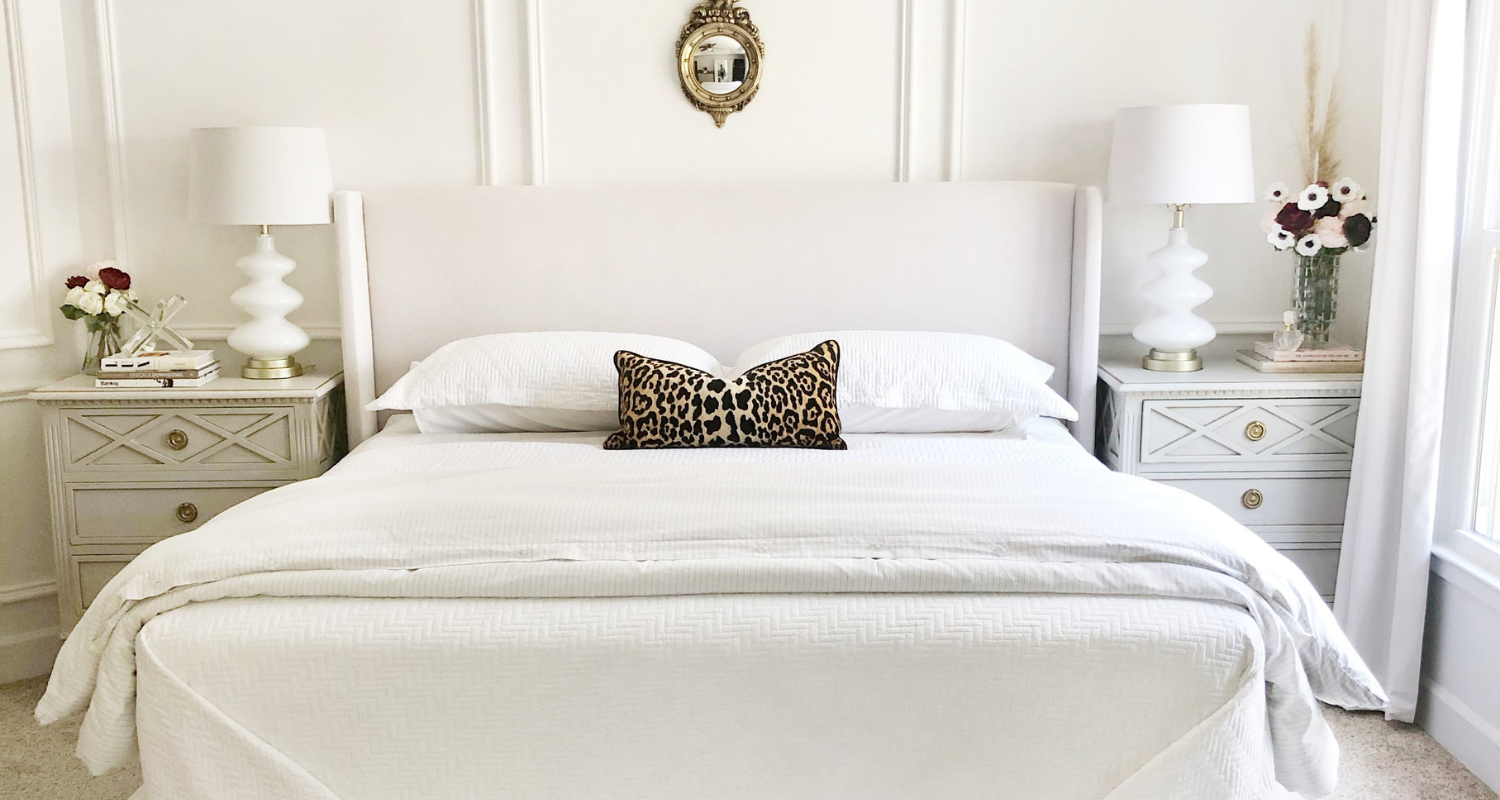 A bedroom where a bedskirt may be out of style.