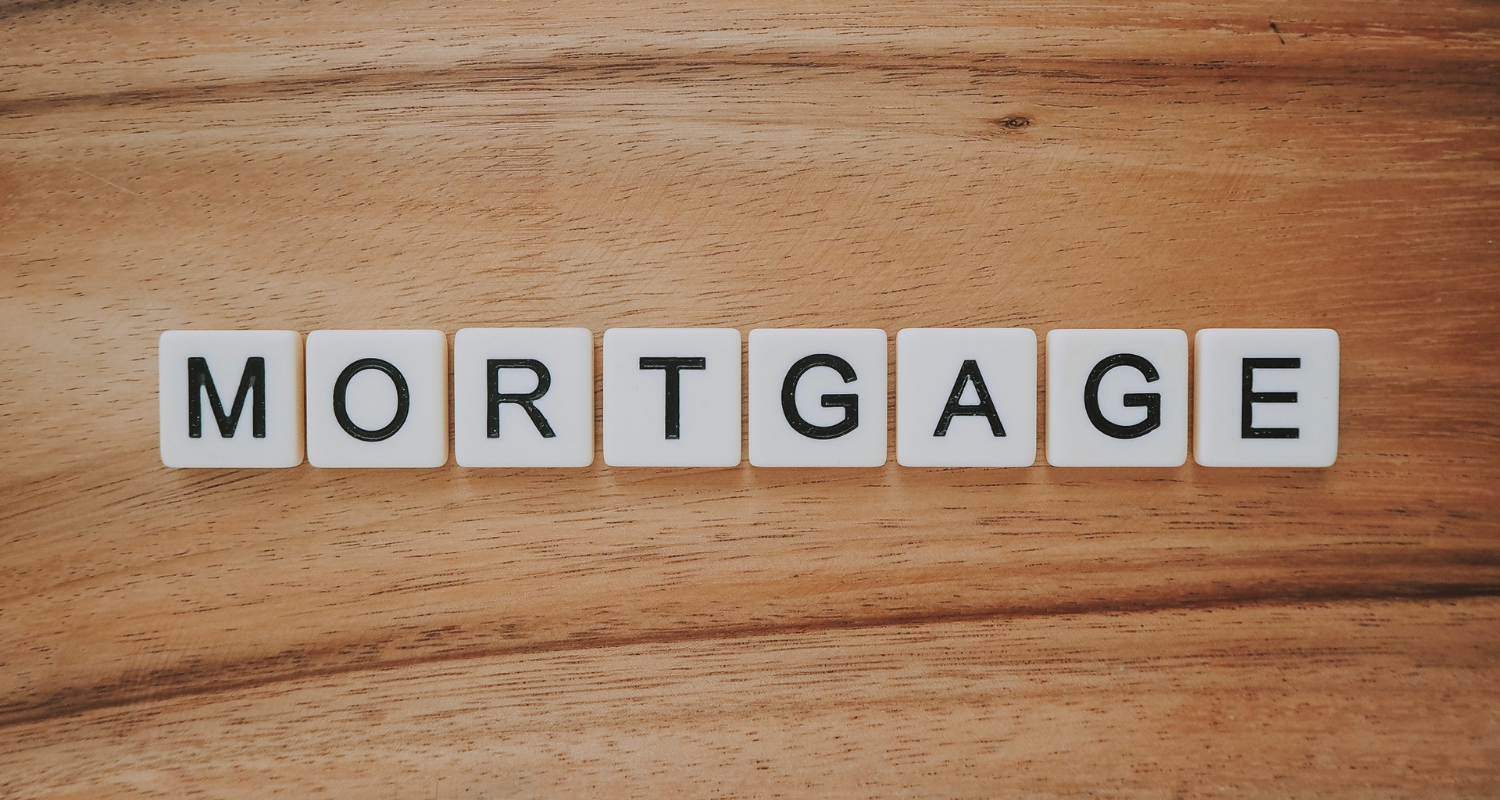 """Scrabble tiles spell out the word """"mortgage"""" as homebuyers contemplate, """"how much mortgage can I afford?"""""""