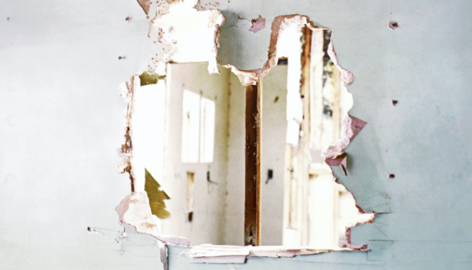 A vandalized wall in a home is something to discuss with a lender before closing.